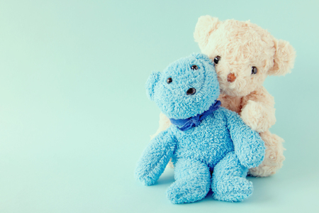 Teddy bears on pastel background ,The couple doll are happy in relationship is lover,Valentine concept.