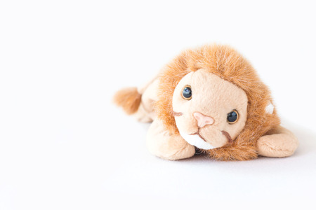 Cute lion lay down with happy and relax Stock Photo