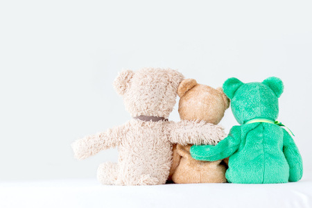 Friendship -three teddy bears holding in ones arms Stock Photo