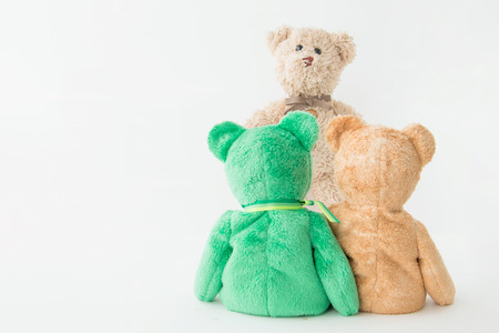 Friendship -couple teddy bears holding in ones arms with big brother stand in front of them