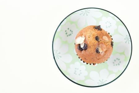 Yummy banana cupcake with whole grain on white background Stock Photo
