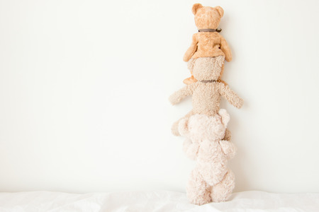 Teddy bears do a pyramid of acrobats, They are playful with a happy feel 스톡 콘텐츠