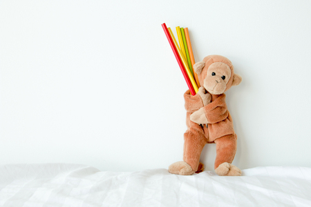 Cute monkey is holding pencils, He would like to draw everything in his mind. 스톡 콘텐츠