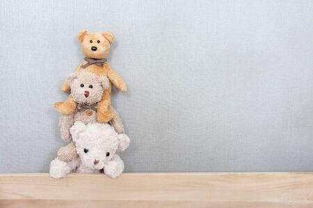 Teddy bears are playing in a row with a happy feel