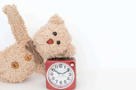 The clock and A cute teddy bear show some simple yoga pose to stretch and strengthen. Stockfoto
