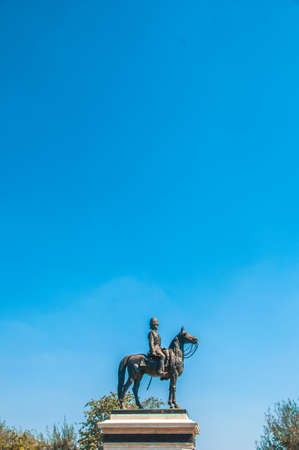 The equestrian statue of King Chulalongkorn Rama V with blue sky background in Bangkok Thailand