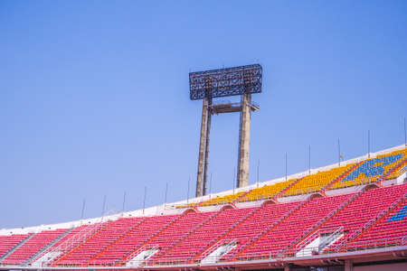 Spotlight inside the football stadium with seats and blue sky background Editorial