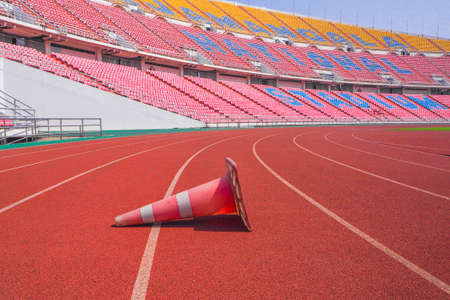 red funnel plastic On the running track with stadium background