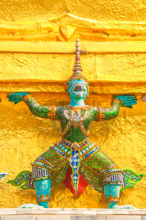 public domain: Giants under golden pagoda, Warrior statue at The Grand Palace and the temple Wat Phra Kaeo. Bangkok. Thailand, They are public domain or treasure of Buddhism. Editorial