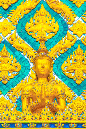 gloden: The Gloden Angel and Garuda Statue with Green Thai Pattern Background At Grand palace and Wat phra keaw Bangkok Thailand. Stock Photo