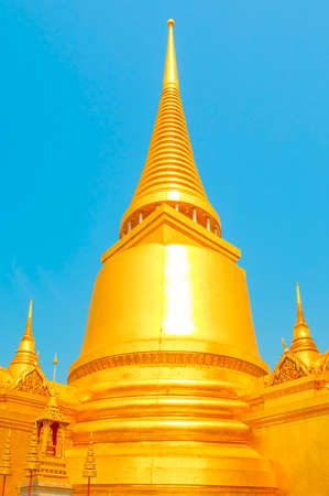 The Golden Pagoda with Blue sky background at Grand palace and Wat phra keaw Bangkok Thailand.