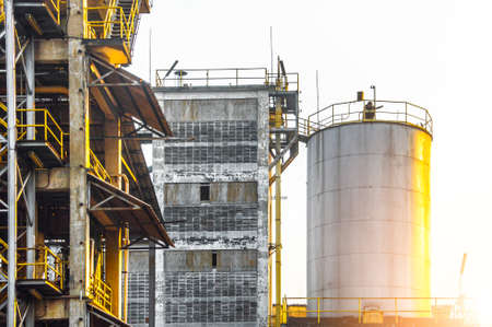 Industrial view at oil refinery plant form industry zone with sunrise sky background