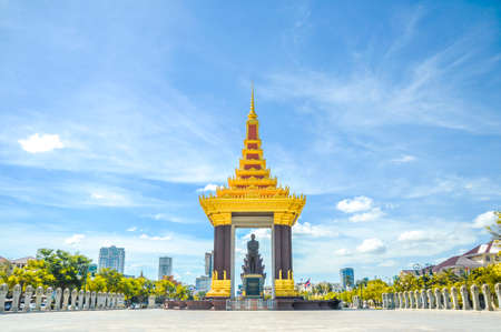 phen: A bronze statue of the late King Father Norodom Sihanouk Statue with blue sky background at Phnom Penh
