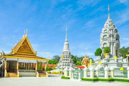 Phnom Penh tourist attraction and famouse landmark - Royal Palace ceremonial pagoda complex, Cambodia with blue sky background Standard-Bild