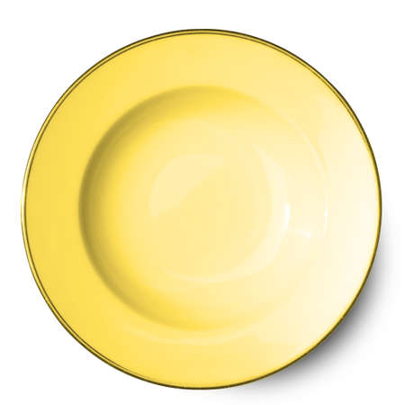 Empty yellow ceramics plate isolated on white background with clipping path.