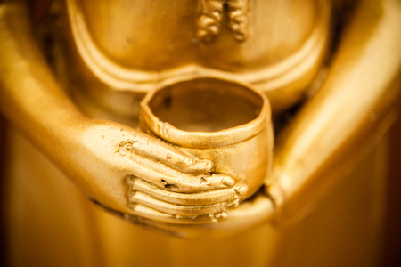 old asian: Hand of golden Buddha