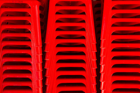 stackable: Red chairs are stackable