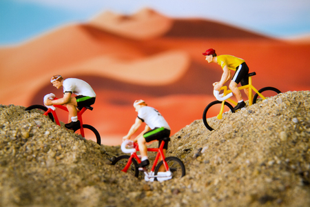 extreme heat: Miniature toy bicycle in desert