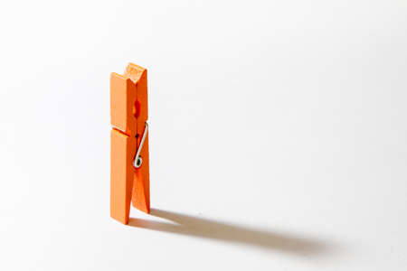 peg: Orange clothes peg Stock Photo