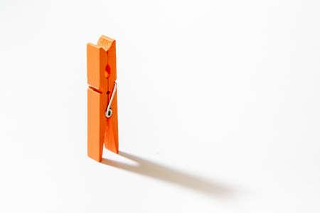 Orange clothes peg Stock Photo