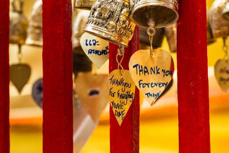 blessings: Gold bell to pray for blessings. Stock Photo