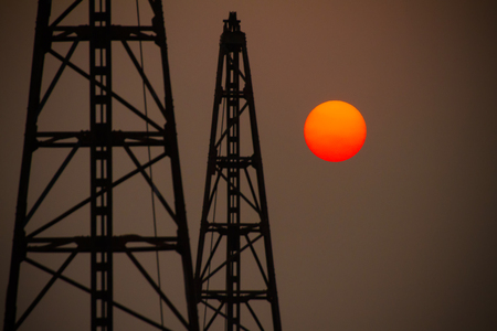 sunspot: Big orange sun sets in the construction zone