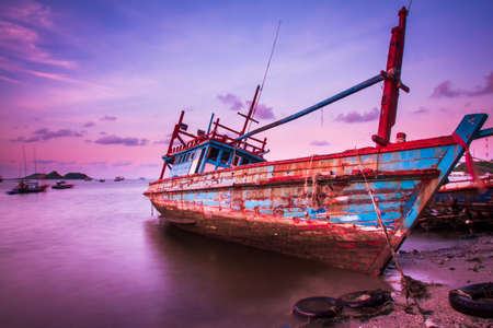 beached: Large fishing boats beached at low tide Stock Photo