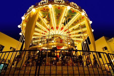 illuminated: illuminated retro carousel at night.