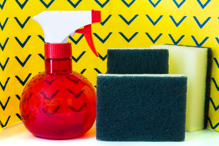 spray bottle: Spray bottle scrubber sponges and yellow cleaning napkins Stock Photo