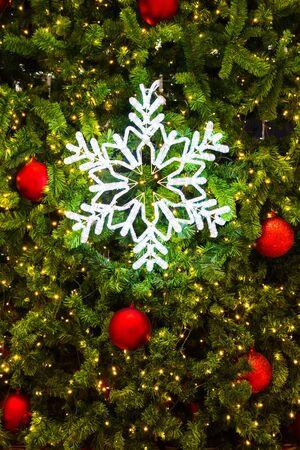 snow flake: Lighting snow flake on a Christmas tree.