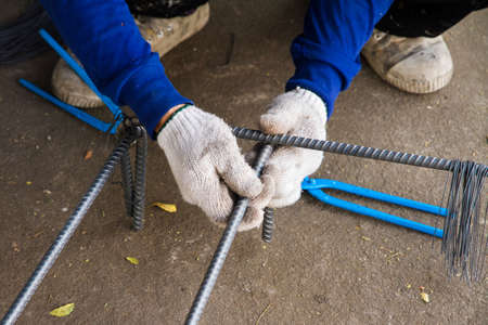 steelworks: working associates of the steel wire reinforcing cage. Stock Photo