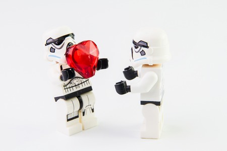 stormtrooper: Nonthabure, Thailand - February, 24, 2016: Lego star wars stormtrooper give red Heart.The lego Star Wars mini figures from movie series on isolated white background, Lego is an interlocking brick system collected around the world by adults and children. Editorial