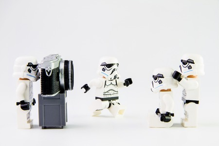 stormtrooper: Nonthabure, Thailand - February, 24, 2016: Lego star wars stormtrooper taking a photograph.The lego Star Wars mini figures from movie series on isolated white background, Lego is an interlocking brick system collected around the world by adults and childr Editorial