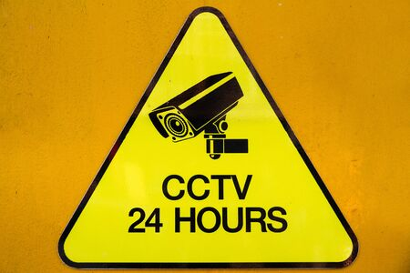 recorded: Yellow warning cctv security cameras sign stating that there is cctv cameras operating 24 hour.