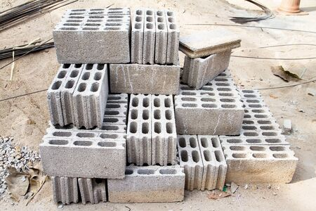 hollow walls: Bricks made of concrete for building of houses and fences. Stock Photo