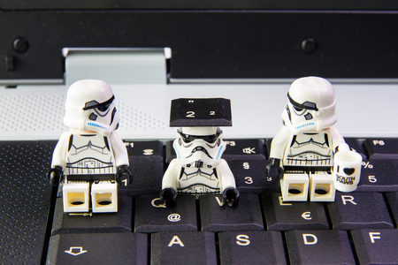 Nonthabure, Thailand - March, 19, 2016: Lego star wars stormtrooper a sneak is key keyboard notebook.The lego Star Wars mini figures from movie series on isolated white background, Lego is an interlocking brick system collected around the world by adults  報道画像