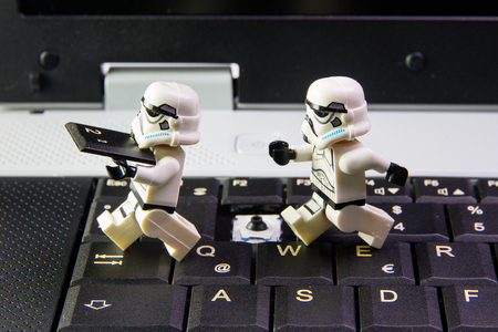 Nonthabure, Thailand - March, 19, 2016: Lego star wars stormtrooper stole keypad keyboard Notebook.The lego Star Wars mini figures from movie series on isolated white background, Lego is an interlocking brick system collected around the world by adults an