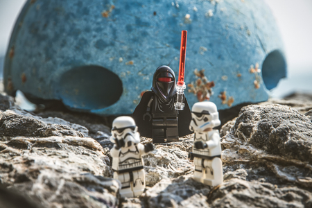 Chonburi, Thailand - April, 10, 2016 : Lego star wars stand on the rock.The lego Star Wars mini figures from movie series.Lego is an interlocking brick system collected around the world.