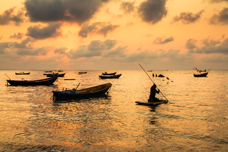 trawl: Fishing boats, small boats floating in the sea at sunrise, Concept sea in the morning. Stock Photo