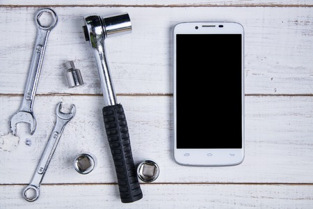 rosin: smartphone and equipment repair on the white wooden background Stock Photo