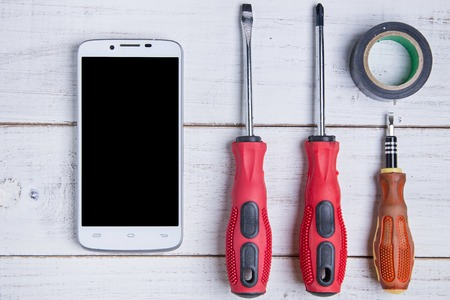 impedance: smartphone and equipment repair on the white wooden background Stock Photo