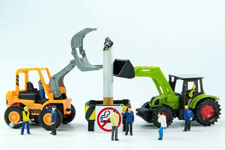 decease: Tiny toys destroy cigarette.Concept No Smoking Day. Stock Photo
