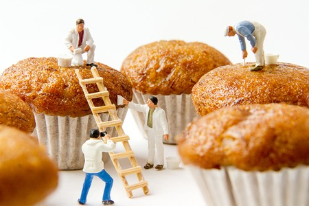 Tiny toys cleaning banana cake.Food background. 写真素材