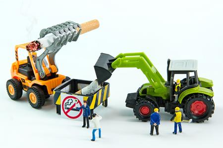 Tiny toys destroy cigarette.Concept No Smoking Day. Stock Photo