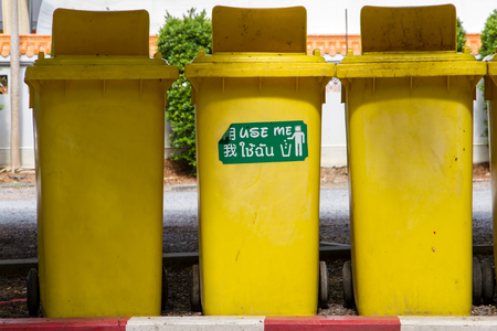 public waste: Yellow Large Trash Box on the floor. Stock Photo