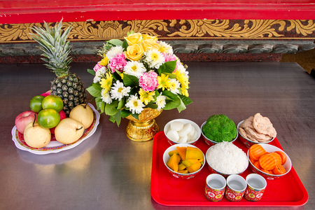 offerings: Traditional offerings to gods with food or vegetable or fruit offerings for the gods of Thailand culture.