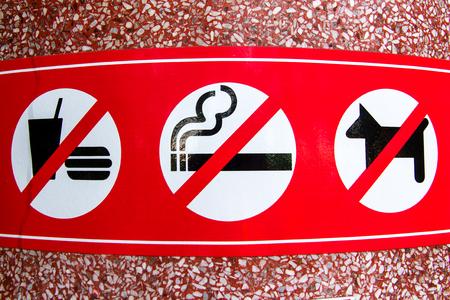 a public notice: No smoking, No Dog, No food sign in public place