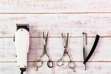 barber scissors: Scissors hairdresser and Clipper Barber on wooden table.