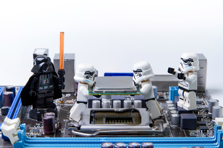 Nonthabure, Thailand - May, 05, 2016: Lego star wars repairing computer motherboard.The lego Star Wars mini figures from movie series.Lego is an interlocking brick system collected around the world. Редакционное