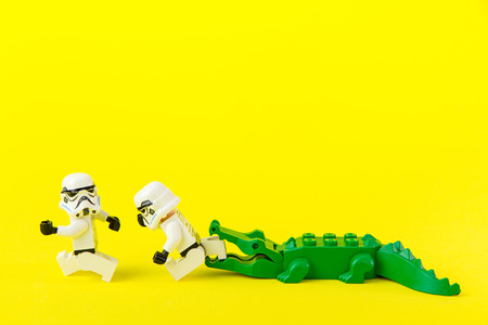 Nonthabure, Thailand - July, 07, 2016: Lego star wars running away crocodile bite.The lego Star Wars mini figures from movie series.Lego is an interlocking brick system collected around the world.